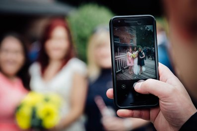 Picture of the bride and guests on a mobile phone