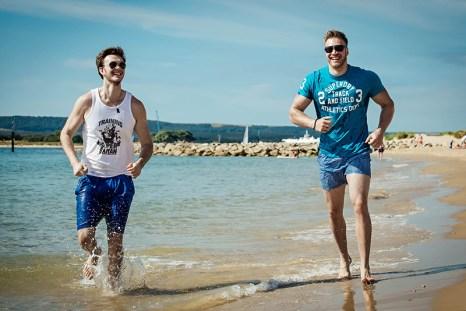 Sons running down Sandbanks Beach