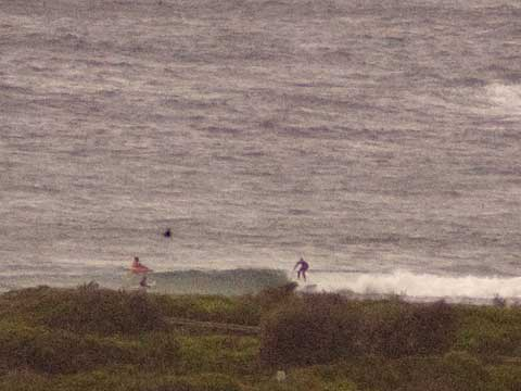 Southerly going past outside and little ones getting into the beach.
