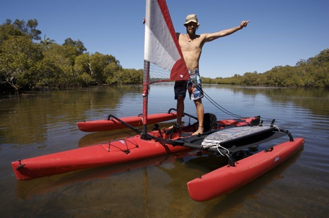 Professional Surfer and environmental campaigner Dave Rastovich and the sea kayak he will navigate to Sydney.