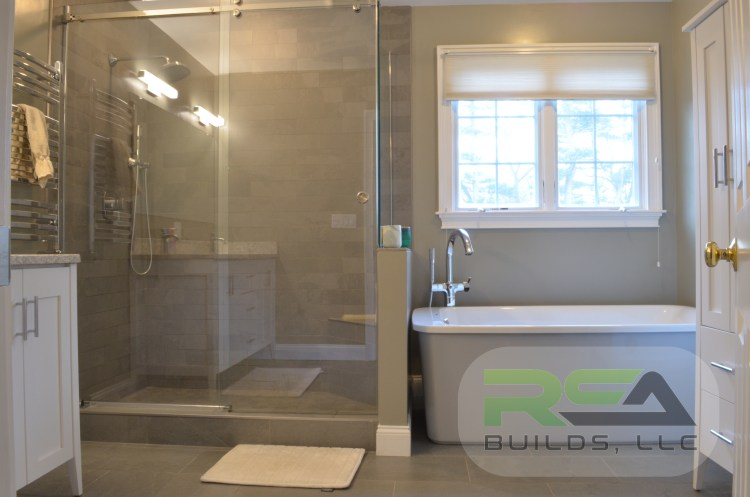 A finished bathroom complete with a separate tub and shower.