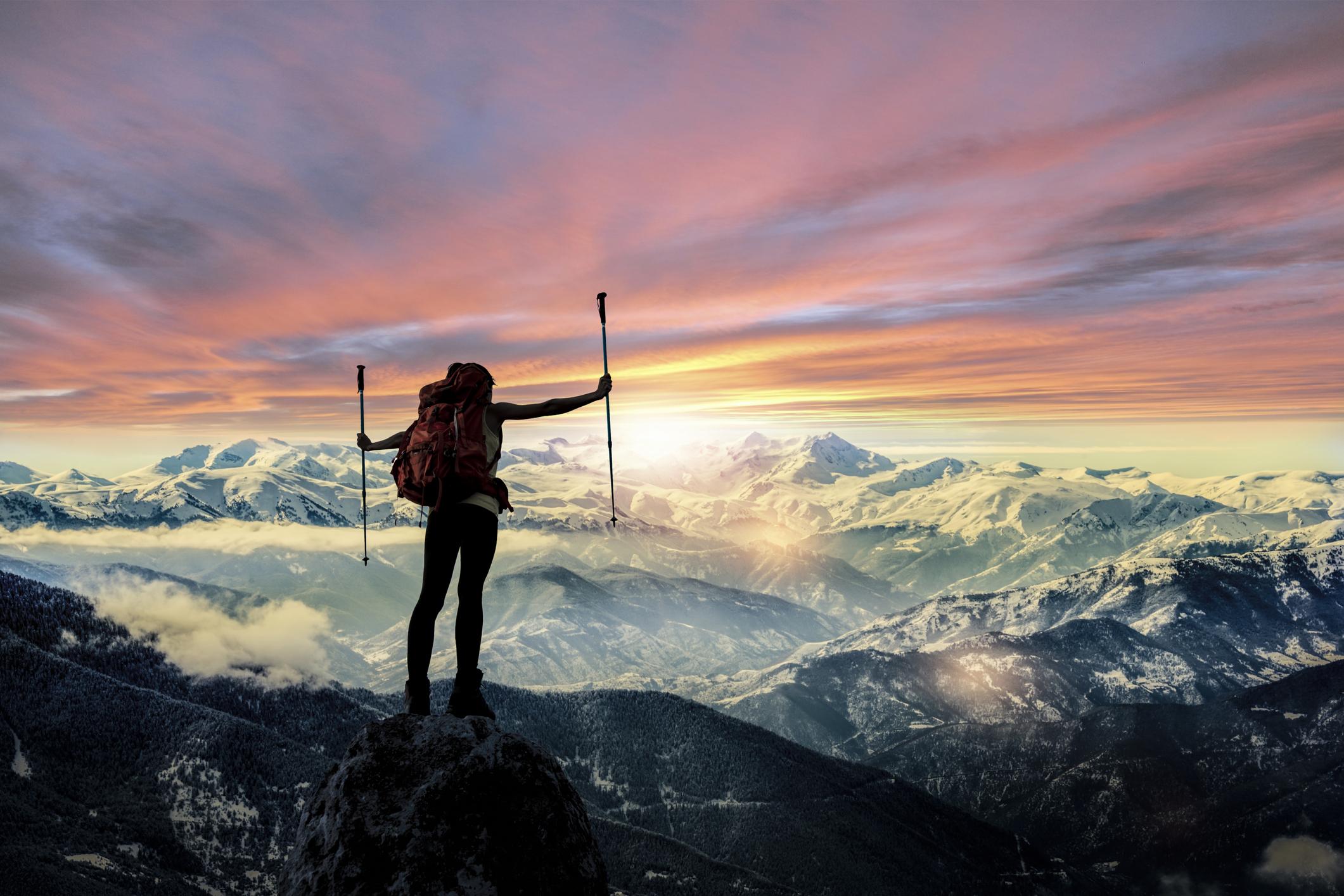 Hiker Silhouette at mountain peak