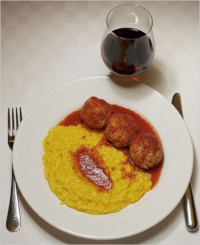 Polpette al pomodoro (meat balls) with risotto.