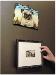 apartment therapy - wood block-hinges-framed picture thermostat cover