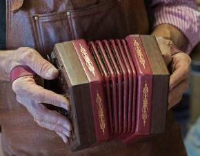 Bob Tedrow holds one of his handcrafted concertinas. (Bernard Troncale)