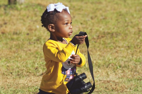 Binoculars aren't required for birdwatching, but they do help bring the details and beauty of birds into sharper focus for birders of all ages, including Summer Grace Joe, daughter of Connecting with Birds and Nature Tours owner Christopher Joe. (Christopher Joe)