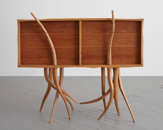 """Wendell Castle created this piece, titled simply """"Chest of Drawers,"""" in 1962 out of oak, walnut, birch and oak plywood. The creation — on loan courtesy of R & Company and the Wendell Castle Estate — is part of the Jule Collins Smith Museum of Fine Art's """"Crafting America"""" exhibition. (Joe Kramm)"""