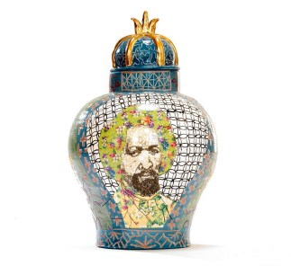"""Artist Roberto Lugo created this Frederick Douglass/Arthur Ashe urn in 2017 using porcelain, China paint and gold luster, and it is part of the collection of Mark McDonald and Dwayne Resnick. It is on display at the Jule Collins Smith Museum of Fine Art as part of the museum's """"Crafting America"""" exhibition. (KeneK Photography/Wexler Gallery)"""