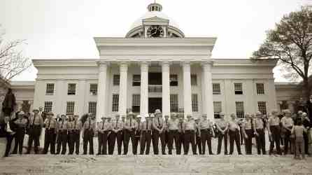 Law enforcement officers stand in front of the Alabama State Capitol on March 25, 1965, at the end of the Selma to Montgomery March. (contributed)
