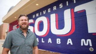 University of South Alabama grad makes mark with retro signs, bold murals