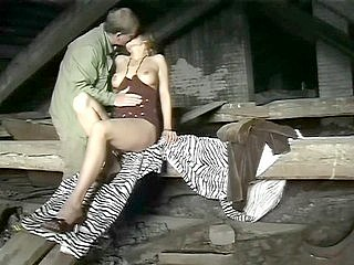 A blond in red lingerie has fuck in the roof space