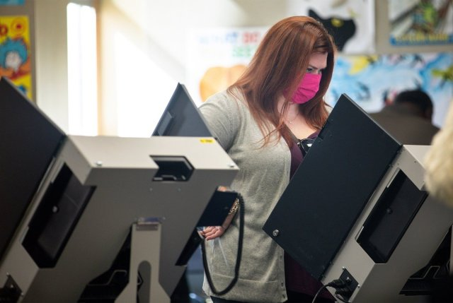 Texas lawmakers reach deal on sweeping voting restriction bill