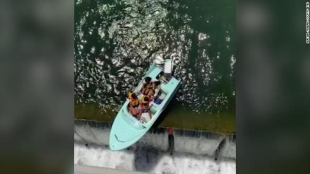 Caught on video: 4 rescued off boat 'teetering' at the edge of a Texas dam