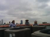 Esotouric's Richard Schave, sign restorer Paul Greenstein and neon historian Nathan Marsak enjoy the view