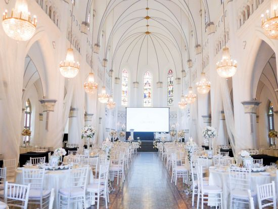 CHIJMES Hall Historical Wedding Venue in Singapore with stained glass windows and chandeliers