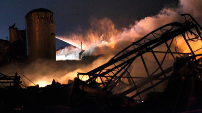 Smoke rises as water is sprayed at the burning remains of a fertilizer plant after an explosion at the plant in the town of West, near Waco, Texas early April 18, 2013 (Reuters / Mike Stone)