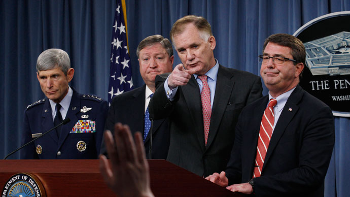 U.S. Deputy Defense Secretary William Lynn (2nd R).(Reuters / Jim Young)