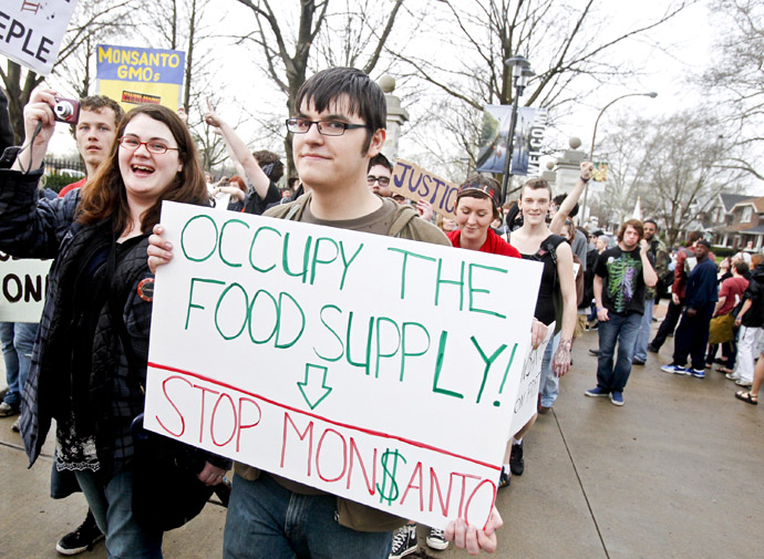 "Members of ""Occupy"" movements in the Midwest protest against Monsanto's agricultural practices in front of the Missouri Botanical Garden during the ""Occupy the Midwest"" regional conference in St. Louis, Missouri March 16, 2012. (Reuters/Sarah Conard)"