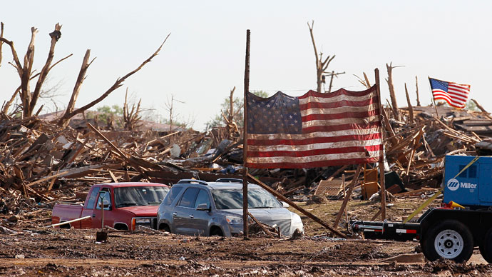 A U.S. flag from the Plaza Towers elementary school is erected on poles in front of the school in Moore, Oklahoma May 22, 2013.(Reuters / Rick Wilking)