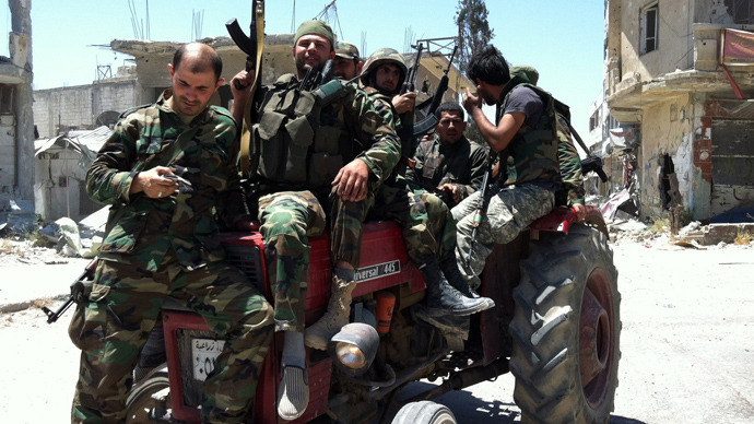 Syrian army's soldiers sit on a tractor holding their weapons on June 5, 2013 in the city of Qusayr in Syria's central Homs province (AFP Photo / Str)
