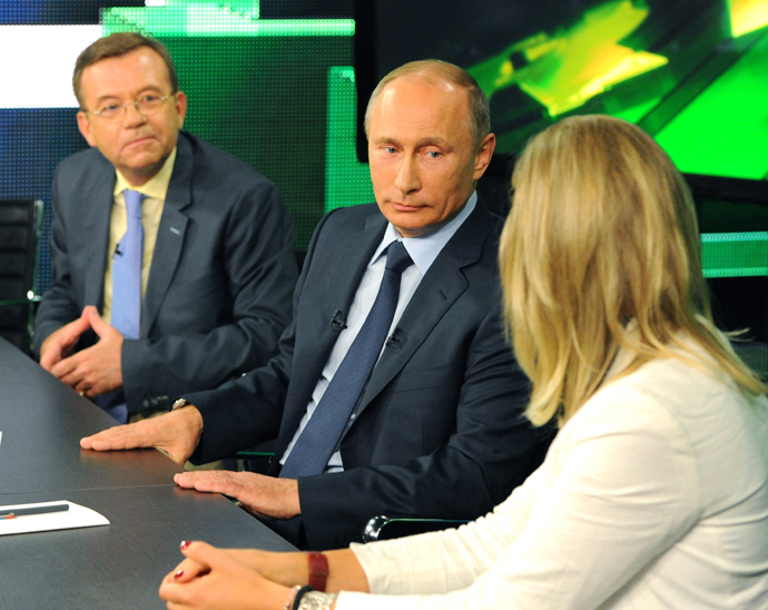 Russian President Vladimir Putin, center, during his talk with Russia Today television channel's journalists and correspondents, June 11, 2013. (RIA Novosti / Michael Klimentyev)