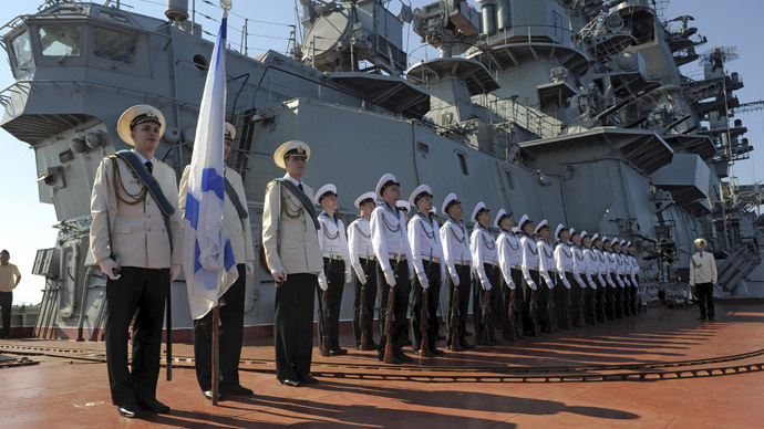 Russia's nuclear-powered missile cruiser Pyotr Veliky navy sailors attend a greeting ceremony for the Russian official delegation at Syria's Mediterranean port of Tartus. (RIA Novosti)
