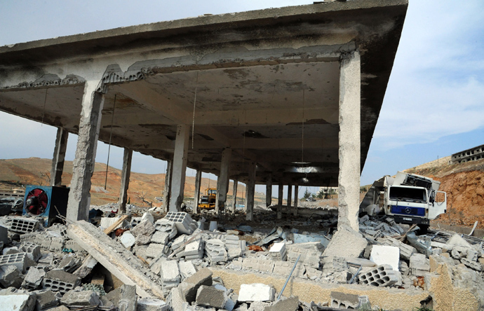 "A handout picture released by the Syrian Arab News Agency (SANA) on May 5, 2013, allegedly shows, ""the damage caused by an Israeli strike"" according to SANA (AFP Photo)"