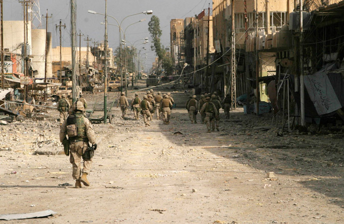 In this U.S. Marine handout picture, which was released on November 23, 2004, Iraqi Special Forces and U.S. Marines from the 2nd Squad, 3rd Platoon, L Company, 3rd Battalion, 5th Marine Regiment of the 1st Marine Division, conduct a security patrol towards the palm grove and clear buildings along the way in the war-torn city of Falluja. (Reuters/HO/USM/Lance Corporal James J. Vooris HH/JV)