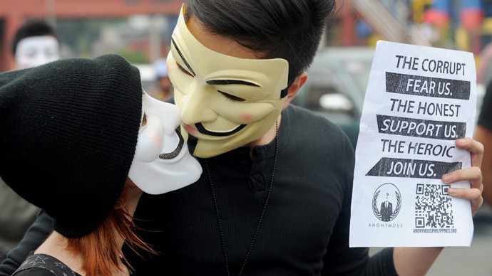 Protesters wearing Guy Fawkes masks attend a rally outside the House of Representatives in suburban Quezon city, north of Manila on November 5, 2013 (AFP Photo / Jay Directo)