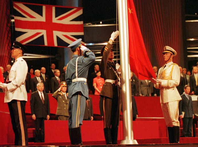 Members of the combined Chinese Armed Forces raise the Chinese Flag at the Hong Kong convention center on July 1, 1997 marking the moment Hong Kong reverted to Chinese rule. (AFP Photo/Kimimasa Mayama)