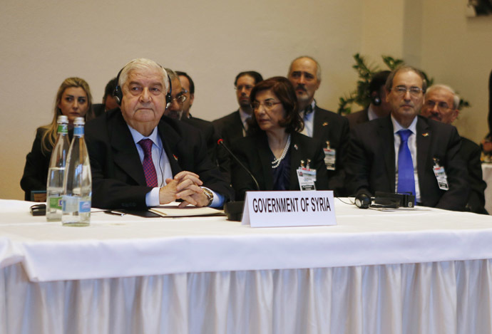 Syria's Foreign Minister Walid al-Moualem (L) leads his delegation during a plenary session in Montreux January 22, 2014. (Reuters/Gary Cameron)