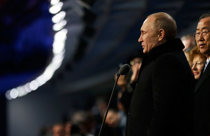 Russian President Vladimir Putin (R) stands to declare the 2014 Winter Olympics open during the opening ceremony on February 7, 2014, in Sochi, Russia.(AFP Photo / David Goldman)