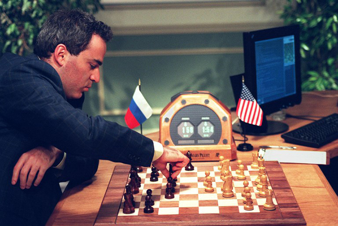 World Chess Champion Garry Kasparov makes a move 07 May in New York during his fourth game against the IBM Deep Blue chess computer, 1997 (AFP Photo / Stan Honda)
