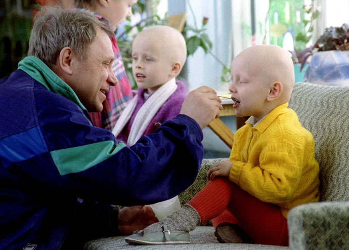 A father feeds his child in the Belarus capital of Minsk special hospital, which deals with radiation related illnesses April 23, 1996. A small amount of radiation escaped at the Chernobyl nuclear power station on the eve of the 10th anniversary of the world's worst nuclear disaster it was reported April 25, 1996 (Reuters)