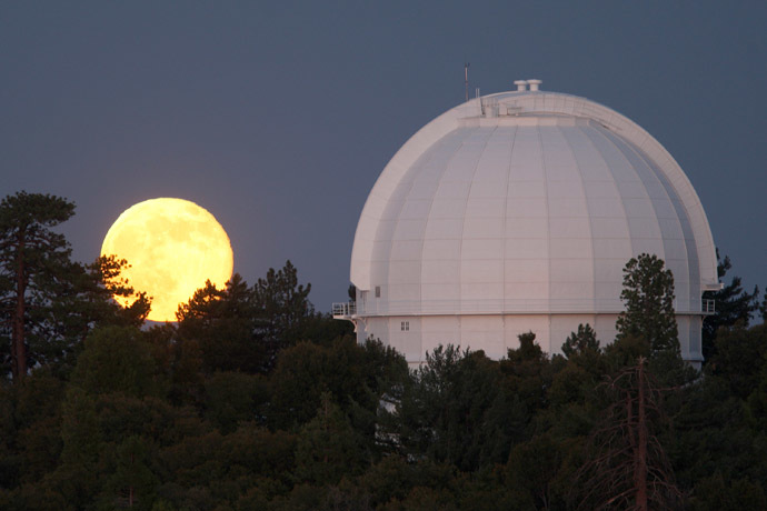 The so-called Supermoon, or perigee moon, rises behind the historic Mount Wilson Observatory on July 12, 2014 at Mount Wilson in the Angeles National Forest northeast of Los Angeles, California. (David McNew/Getty Images/AFP)