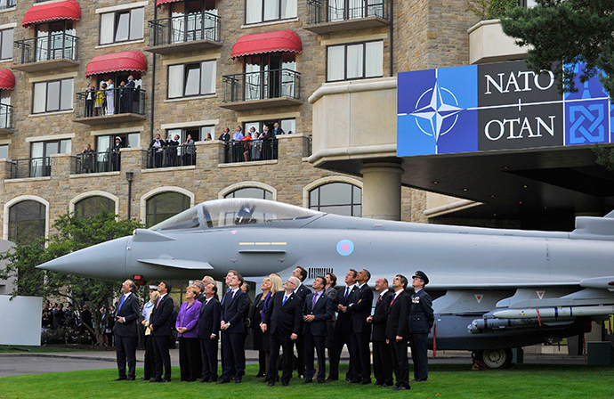 NATO leaders watch a fly-past by the Red Arrows during the NATO summit at the Celtic Manor resort, near Newport, in Wales September 5, 2014 (Reuters / Rebecca Naden)