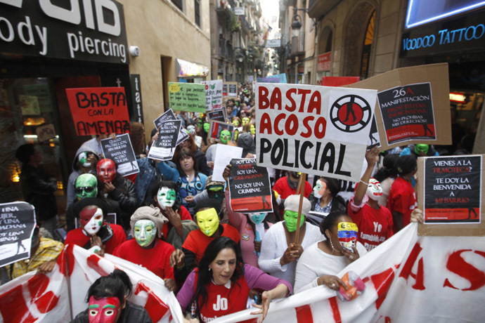 """Members of the platform of """"Indignant Prostitutes"""" and their supporters staged a demonstration in central Barcelona to protest against the city's plans to modify a law that seeks to prohibit street prostitution in the Catalan capital, April 26, 2012. (Reuters/Gustau Nacarino)"""