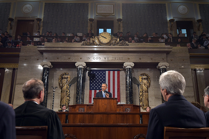 U.S. President Barack Obama (C) delivers his State of the Union address to a joint session of Congress on Capitol Hill in Washington (Reuters / Mandel Ngan)