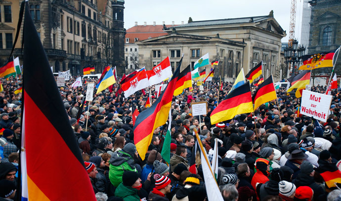 Members of the movement of Patriotic Europeans Against the Islamisation of the West (PEGIDA) hold flags and banners during a PEGIDA demonstration march in Dresden, January 25, 2015. (Reuters / Hannibal Hanschke)