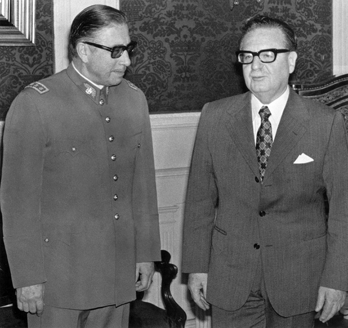 General Augusto Pinochet (left) poses with Chilean president and Marxist leader Salvador Allende 23 August 1973 in Santiago. (AFP Photo)