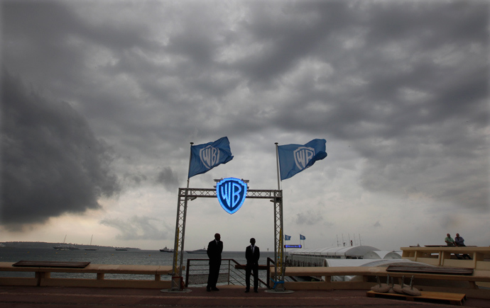 Security guards stand at the entrance of the Warner Bros beach (Reuters / Eric Gaillard)
