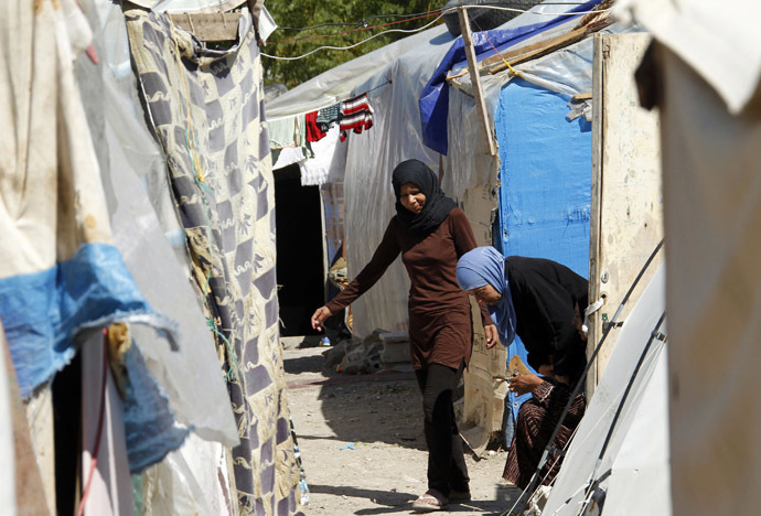 Palestinian refugee women from Syria plays are seen outside their tents at Ain al-Helweh Palestinian refugee camp near the port-city of Sidon, southern Lebanon (Reuters/Ali Hashisho)