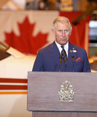 Prince Charles, Prince of Wales gives a speech as he visits Stevenson Campus Air Hanger on May 21, 2014 in Winnipeg, Canada.(AFP Photo / Chris Jackson)