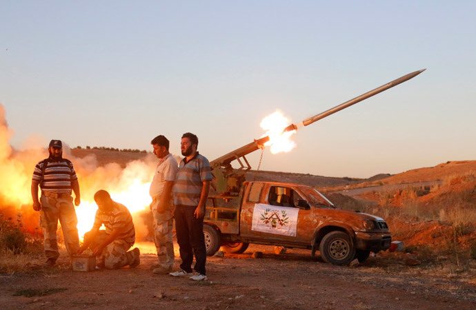 Free Syrian Army fighters launch a rocket towards Hama military airport that is controlled by forces loyal to Syria's President Bashar al-Assad, in the Hama countryside July 25, 2014. (Reuters / Badi Khlif)