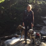 RTC:Rural Training Associate Maggie Lawrence in the woods with her dogs