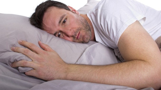 man in bed depressed