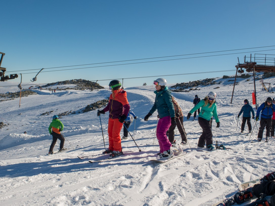 skiers at the summit