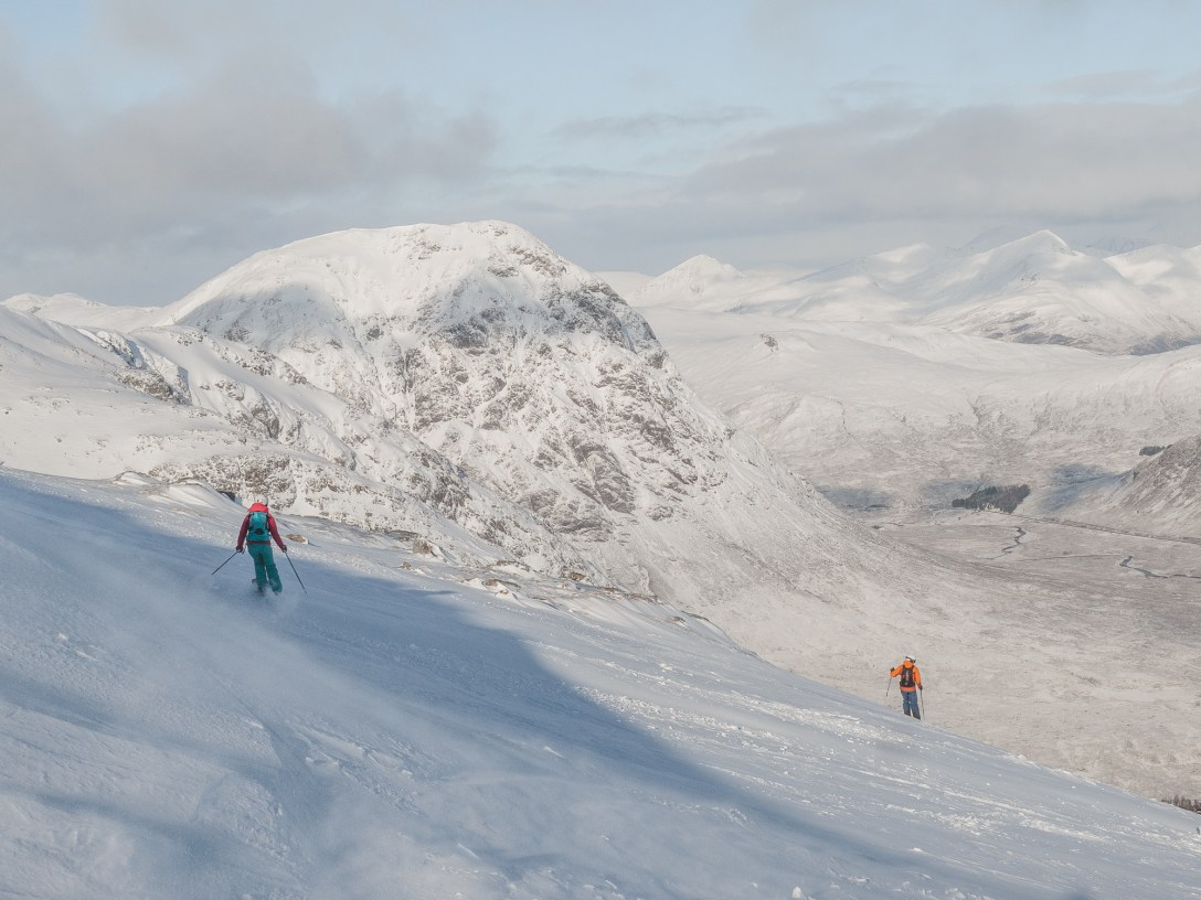 two skiers with Buachaille Etive More in background