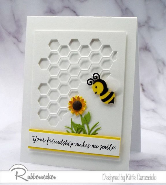 One of Kittie's Bee Cards with a white on white design and bright pops of color for the flower and bee
