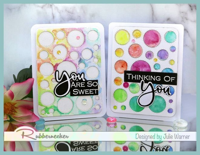 make two cards using one die cut for the main element like the colorful circles and circle frame on these cards